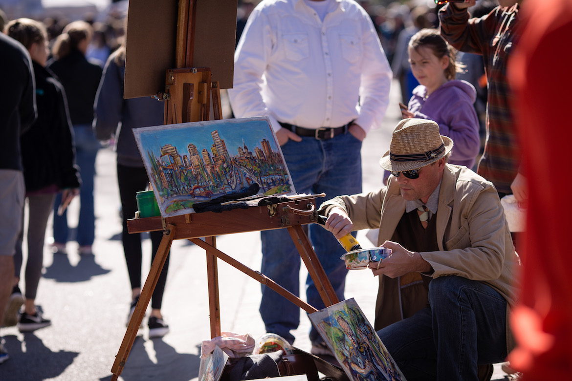 Artist Trahern Cook paints for the crowds at Soda City Market